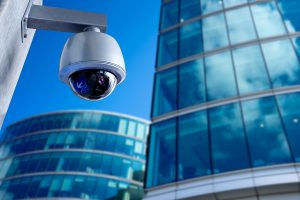 A security system camera on the side of a commercial building